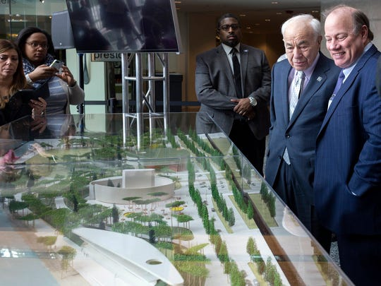 Ralph C. Wilson Jr. Foundation Trustee, Eugene Driker, left, stands next to Detroit Mayor Mike Duggan, as people gather around the West Riverfront Park model by the winning firm Michael Van Valkenburgh Associates on Tuesday, April 10, 2018, at the General Motors Renaissance Center in Detroit. Michael Van Valkenburgh Associates and David Adjaye, Principal of Adjaye Associates will reimagine the 22 acre West Riverfront Park in Detroit.
