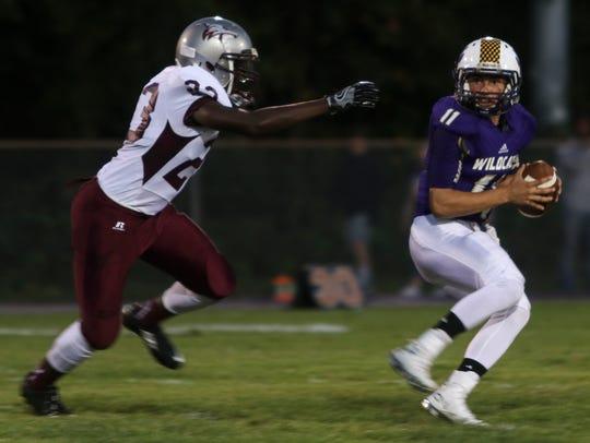 Clarksville High's quarterback Skyler Luma (11) looks