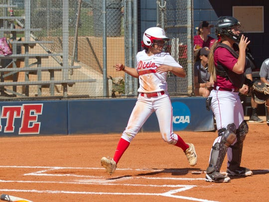 Dixie State outfielder Janessa Bassett scores a run during their game against Colorado Mesa Thursday, March 26, 2015.