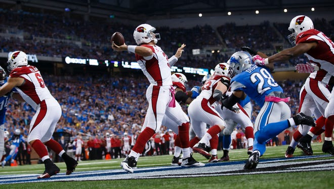 Quarterback Carson Palmer passes during the Cardinals' 42-17 win over the the Lions at Ford Field, Oct. 11, 2015.