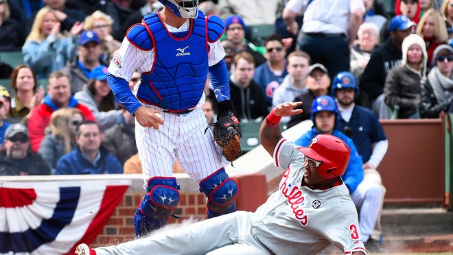 The Phillies' Marlon Byrd is forced out at home Sunday.