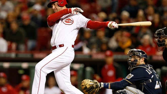 Reds left fielder Ryan Ludwick hits a two-run single against Milwaukee on May 1.