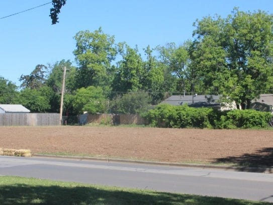 This lot is what remains of three MSU-owned homes on