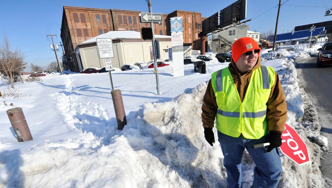 """""""It's not really safe."""" said crossing guard Eric Smith who was helping get students from the corner of Philadelphia and Broad streets, to Alexander B. Goode K-8 School on Thursday. Smith, who has been a guard at that corner for the past five years, redirected walkers to the streets after the sidewalk area where he was working had not been cleared."""