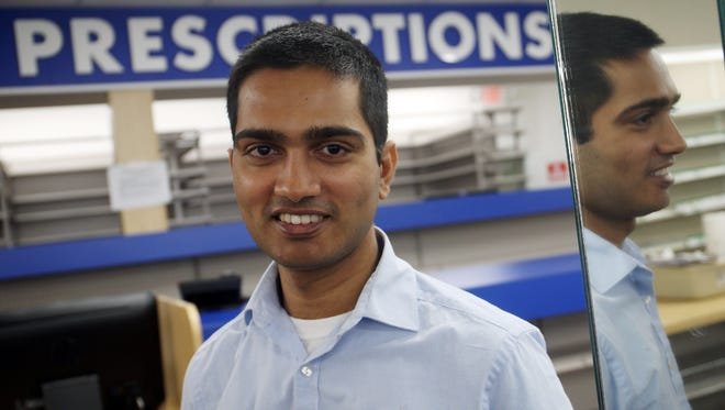 Farmingdale Pharmacy owner Hitesh Patel has brought the pharmacy back from its sudden closure last year.