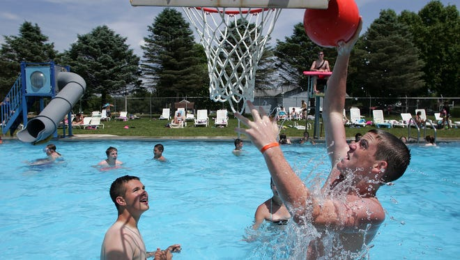 Donnie Kehl and Gannon Unger, then 14, shoot hoops in the River View Community Pool in this Tribune file photo. The pool will be closed for 2020 relating to maintenance issues and operating at a loss per guidelines for opening from the state related to the COVID-19 pandemic.