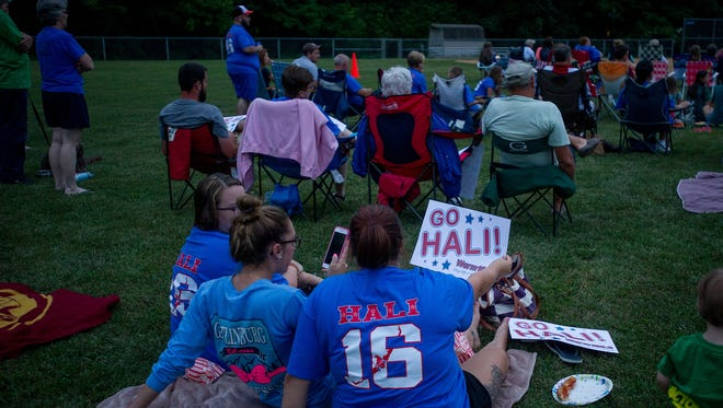 People gather at Spring Grove Community Park waiting to watch Spring Grove native Hali Flickinger compete in an Olympic semifinal swim on Tuesday, Aug. 9, 2016.