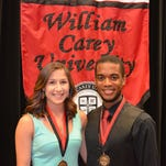 Pictured are Morgan Marfisi (left) of Tomball, Texas, and Carlos Casilla of Santo Domingo, Dominican Republic, recipients of the Jenkins-Chastain Citizenship Awards, during the William Carey University Honors Convocation on April 29. The Jenkins-Chastain Awards are the highest honor given by Carey and recognize students who exemplify strong qualities of citizenship as upheld by the university.