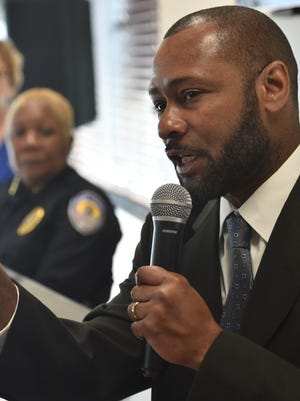 Chief Noble Wray, head of the COPS Office Policing Practices and Accountability Initiative with the Department of Justice, speaks alongside Fort Pierce Mayor Linda Hudson, left, and police Chief Diane Hobley-Burney during a Nov. 20, 2016, news conference.