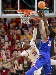 Iowa State's Solomon Young (33) fouls Kansas' Udoka