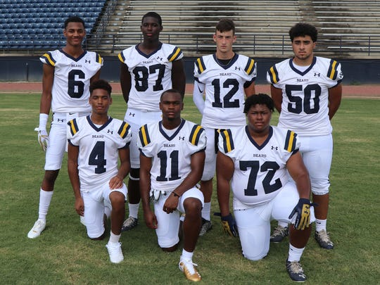 Carencro's offensive lineup includes (front, from left) Shemar Gotch, Treylon Barnaba, Kane Flugence, (back, from left) Deion Senegal, Skyron Littleton, Austen Breaux and Vaughn Johnnie.