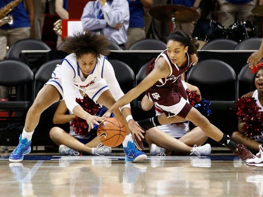 Southern Methodist guard Kiara Perry, left, and Texas A&M guard Curtyce Knox, right, battle over a loose ball during the first half of an NCAA college women's basketball game, Tuesday, Dec 9, 2014, in Dallas. (AP Photo/Jim Cowsert)
