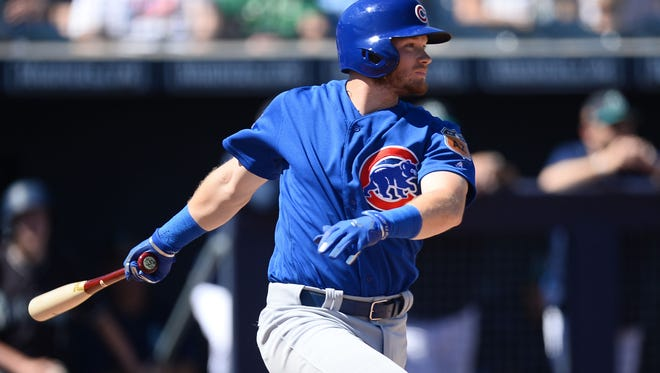 Chicago Cubs center fielder Ian Happ (86) hits a single against the Seattle Mariners during the second inning at Peoria Stadium on March 10.