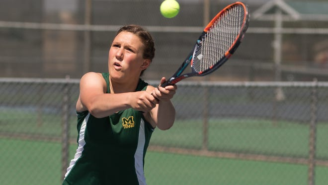 Mayfield High School tennis player McKenna Thelen concentrates on her return at the MHS Tennis Tournament held at Lions Park on Saturday.
