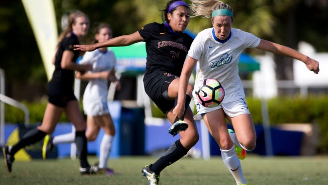 FGCU's Ali Rogers, right, and Lipscomb's Jade Abarca fight for possession of the ball in the second half of action in the ASUN Championship Final at the FGCU Soccer Complex Sunday, November 6, 2016 in Estero. FGCU would defeat Lipscomb 2-0 clinching an NCAA tournament berth.