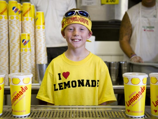"Dylan Salois, 9, works as the ""boss"" of the Jumbo Lemonade"