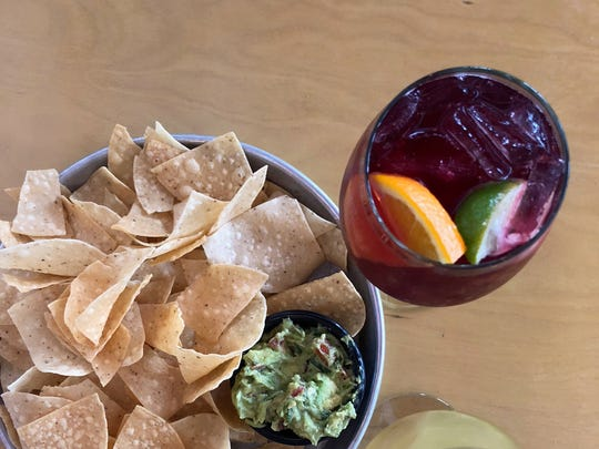 Pair an order of homemade guacamole with a red or white sangria.