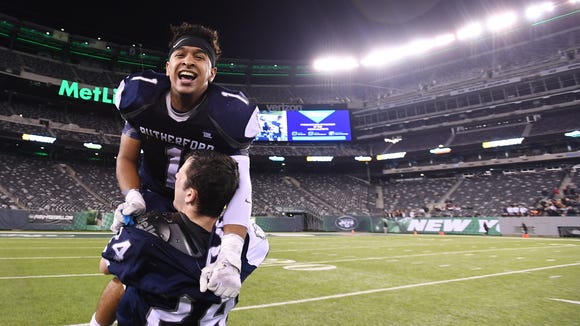 North 2, Group 2 state football final. Rutherford vs. Hackettstown at MetLife Stadium in East Rutherford, on Thursday, November 30, 2017. R #1 Abellany Mendez celebrates defeating Hackettstown.