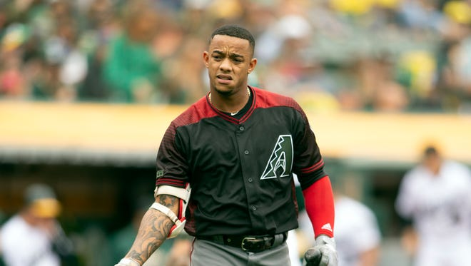 Arizona Diamondbacks Ketel Marte (4) tosses his helmet after striking out to end the top half of the fourth inning of a baseball game against the Oakland Athletics, Saturday, May 26, 2018, in Oakland, Calif.