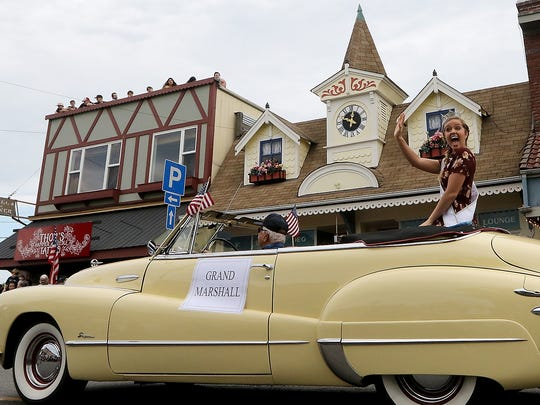 Miss Washington Nicole Renard waves to the crowd as she fills the role of the Grand Marshall of the Viking Fest Parade in downtown Poulsbo, Washington on Saturday, May 19, 2018.