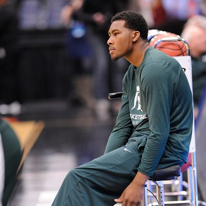 Javon Bess sits on his scooter during MSU's practice Thursday at the Carrier Dome in Syracuse, N.Y. The freshman had surgery twice on his right foot this season, first in October and again two weeks ago. He is out for the rest of the season and hopes to get back on the court this summer.