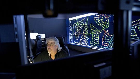 APS operator Dennis Barksdale monitors a power grid at the control center in Phoenix on June 2, 2016.