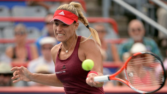 Angelique Kerber hits a forehand against Daria Kasatkina.