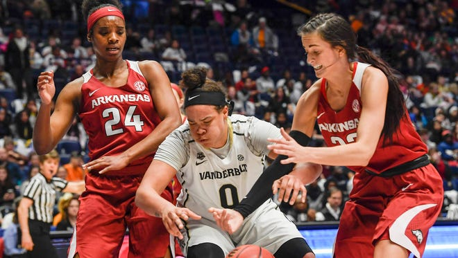 Vanderbilt Commodores forward Kayla Overbeck (0) is fouled by Arkansas Lady Razorbacks guard/forward Bailey Zimmerman (22) in the first half of the round one of the SEC Women's Basketball Tournament at the Bridgestone Arena in Nashville, Tenn., Wednesday, Feb. 28, 2018.
