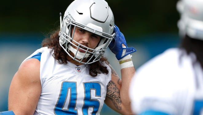 Detroit Lions running back Nick Bawden (46) adjusts his helmet during practice at the Lions Headquarters and Training Facility on Tuesday, June 5, 2018.