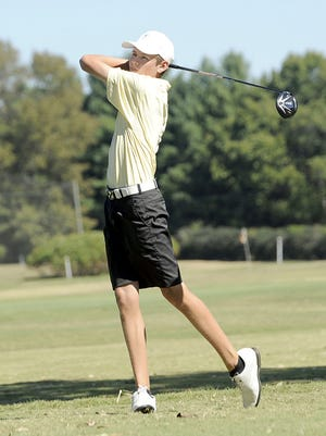 Hendersonville junior Bryce Lewis watches his tee shot on hole No. 1.
