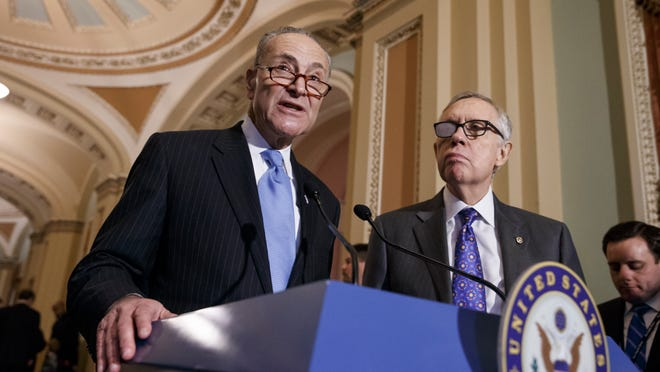 FILE - In this March 3, 2015 file photo, Sen. Charles Schumer, D-N.Y., left, accompanied by Senate Minority Leader Harry Reid, D-Nev., speaks during a news conference on Capitol Hill in Washington. Reid is backing Schumer to succeed him as Democratic leader.  Reid issued his endorsement Friday morning, shortly after announcing he would be retiring next year instead of running for re-election.  (AP Photo/J. Scott Applewhite, File) ORG XMIT: WX107