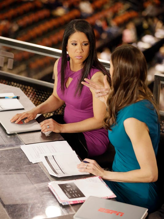 """In this Sunday, April 3, 2016 photo, Kara Lawson, left, and Rebecca Lobo talk before a ESPN show before a national semifinal game at the women's Final Four in the NCAA college basketball tournament in Indianapolis. The witty banter that viewers see on-air is even more prevalent when the cameras stop rolling. """"Some of the best stuff happens when we're off camera,"""" Lobo said. """"Kara would say something and we're like you got to use that on air."""" (AP Photo/Darron Cummings)"""