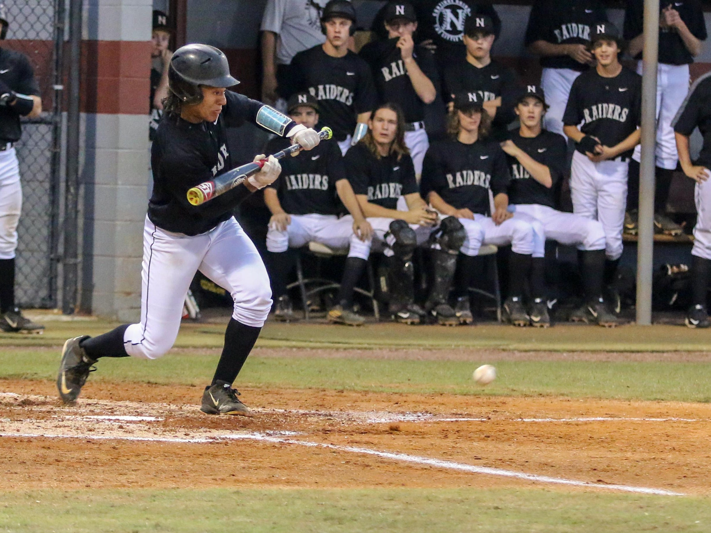 Navarre's Octavien Moyer lays down a sacrifice bunt to advance the runners to third and second bases Wednesday night during the Region 7A quarterfinal game at Tate High School.