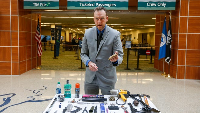 Mark Howell, the regional spokesperson for the TSA, displays a pair of brass knuckles while talking about prohibited items at the Springfield-Branson National Airport on Thursday, Feb. 22, 2018.