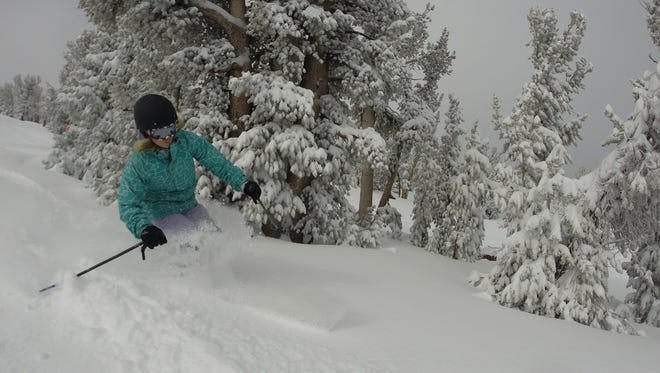 A skier makes powder turns at Heavenly Mountain Resort in South Lake Tahoe. Vail Resorts, which operates Heavenly, recently reported in an increase in pass sales for the 2015-16 ski season.