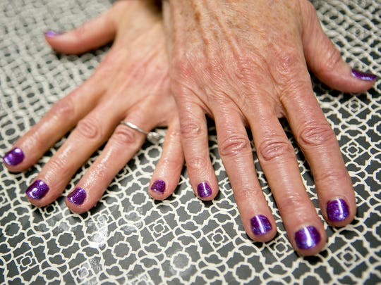 Robin paints Joni's nails a fun shade of purple at