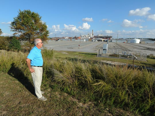 Representative Danny Short (R-Seaford) stands and looks at the Invista plant parking lot.  The Invista plant used to be DuPont's nylon factory, which employed 1,200. The parking lot is built to hold 3,000 vehicles.