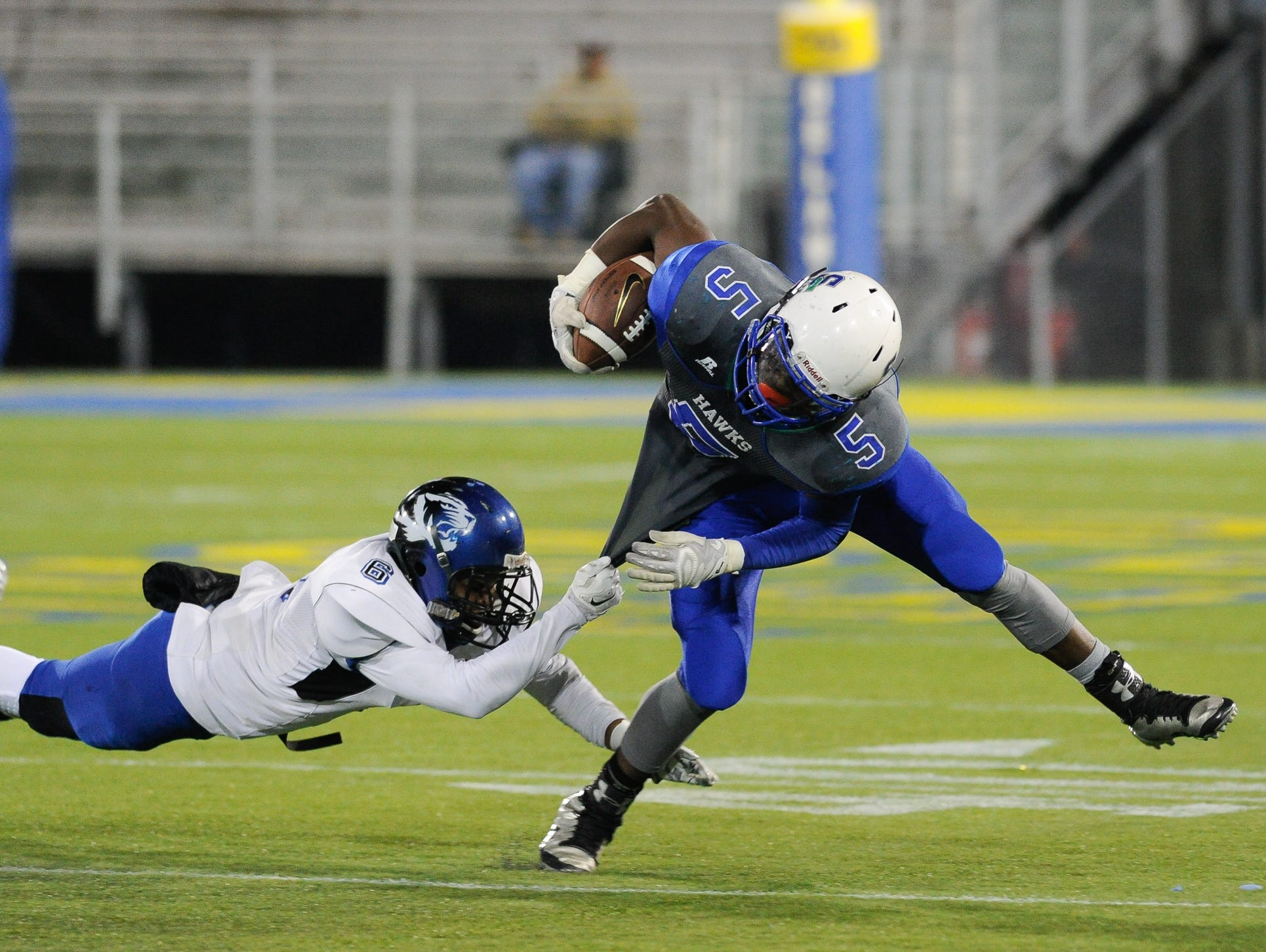 Howard's #6 Johnnie Johnson tackles St. George's #5 Angelo Ortiz during the Division II championship at the University of Delaware.