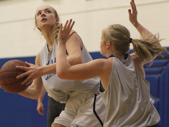 Senior Gena Grundhoffer, left, goes against senior Macyn Krings during basketball practice at Assumption High School in Wisconsin Rapids, Tuesday, March 8, 2016.