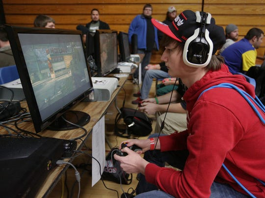Derek Deitrich of Reedsburg plays 'Call of Duty' at the EVERCON gaming convention at D.C. Everest Junior High School in Weston in 2013.