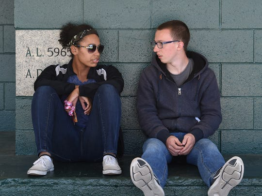 Elizabeth Long and Neil Penrod sit outside of Sparks Middle School, where they watched their teacher get shot and killed in 2013.