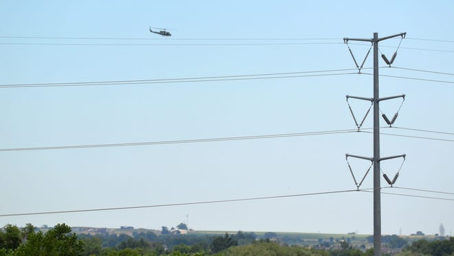An Air Force helicopter searches for a missing man in northeast Fort Collins on Monday, July 7, 2014.