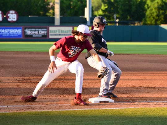 Florida State first baseman Drew Mendoza attempts to tag out a Pacific baserunner during the Seminoles 5-3 victory on Saturday night at Dick Howser Stadium.