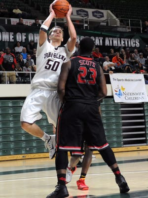 John Glenn's Drew Rackley takes a shot over Walnut Ridge's Tarik Wright during the Division II regional finals Saturday at Ohio University in Athens. The junior was the MVL boys basketball player of the year and one of seven unanimous first-team selections.