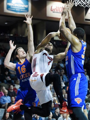 The Skyforce's Rodney McGruder (4) tries to get a shot between Westchester Knicks' Jimmer Fredette (16) and Keith Wright (35) Friday night at a NBA D-League playoff game at the Sanford Pentagon, April 8, 2016.