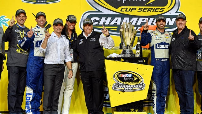 Crew chief Chad Knaus, left, Jeff Gordon, second from left, Rick Hendrick, center, and Jimmie Johnson, right, celebrate Johnson's record-tying seventh NASCAR Sprint Cup championship Sunday.