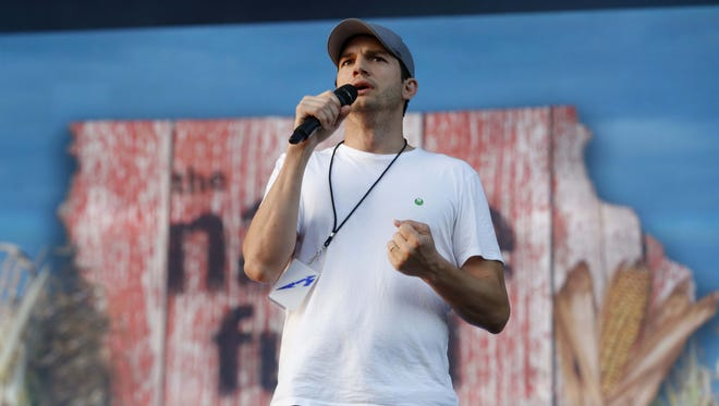 Ashton Kutcher and Dallas Clark take the stage before Metallica performs Friday, June 9, 2017, at the Iowa Speedway in Newton.