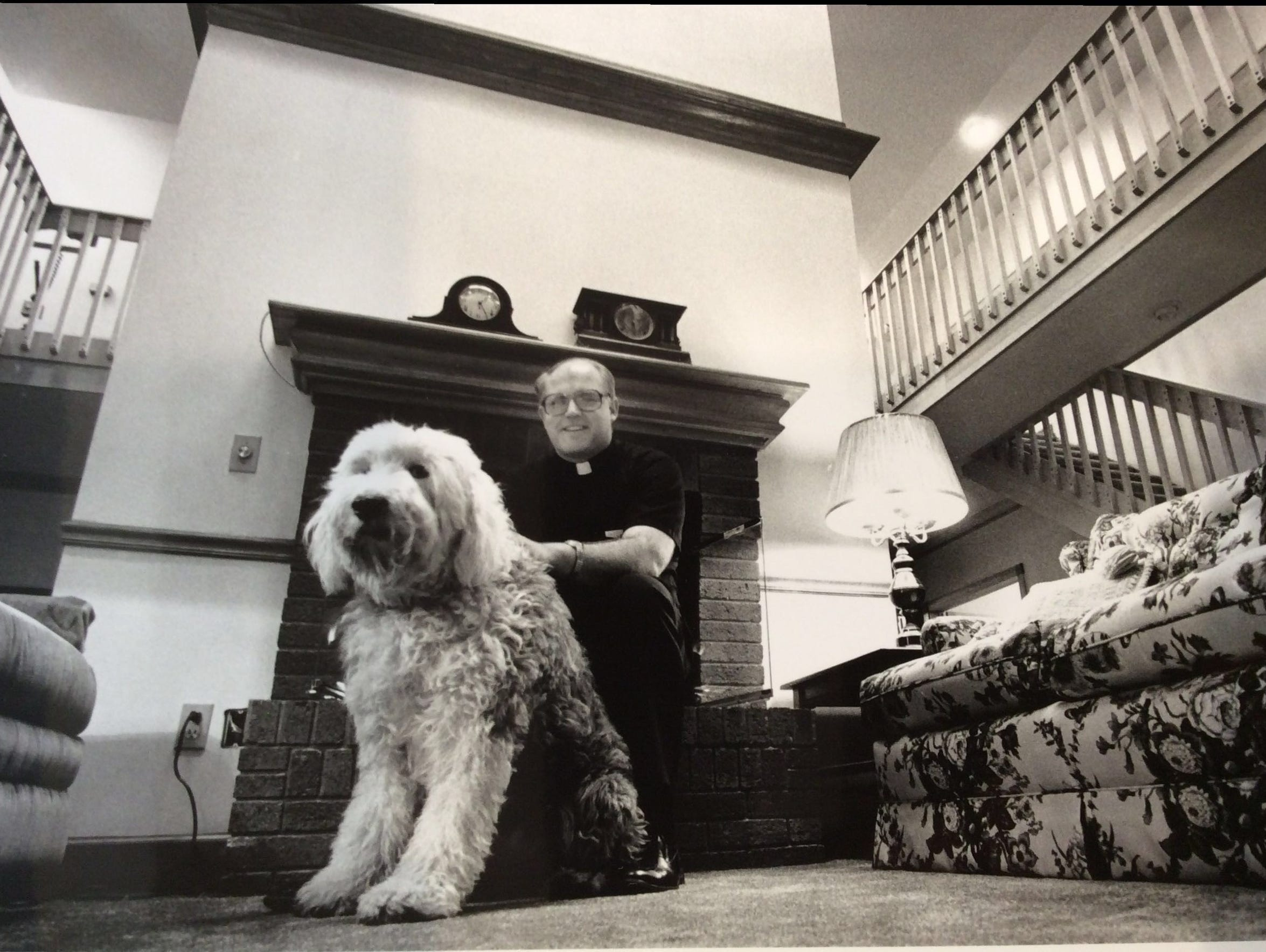 The Rev. Jonathan Wehrle poses with his sheepdog Thumper