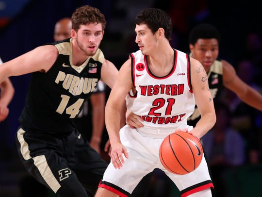 Western Kentucky Hilltoppers guard Jake Ohmer (21) dribbles as Purdue Boilermakers guard Ryan Cline (14) defends during the first half in the 2017 Battle 4 Atlantis in Imperial Arena at the Atlantis Resort. Mandatory Credit: Kevin Jairaj-USA TODAY Sports