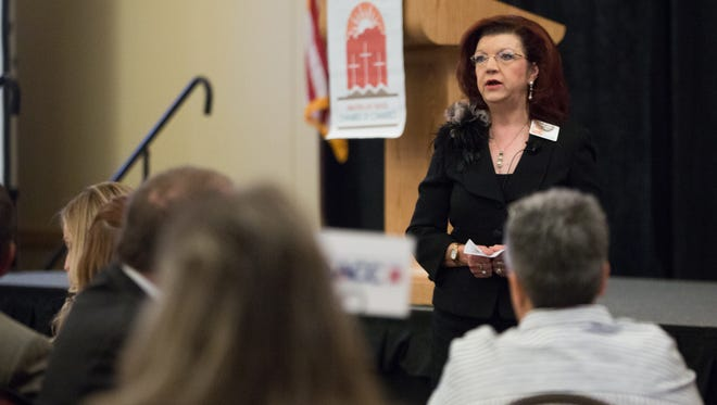 Debbi Moore, Greater Las Cruces Chamber of Commerce president and CEO, gives a brief introduction to the legislators and local business leaders gathered at the Las Cruces Convention Center, Wednesday, December 14, 2016, during the 2016 Legislative Sendoff Breakfast.